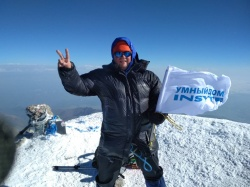 INSYTE Electronics flag hoisted to the top of mount Elbrus